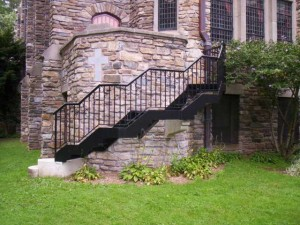 Outside staircase with railings to replace old concrete and iron stair that was unsafe.