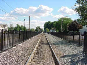 Decorative safety fence along both sides of the track at the Hamilton Railroad station for the MBTA commuter railroad in Hamilton, MA.