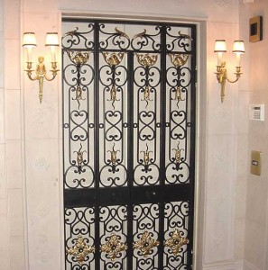 Wrought Iron double bifold security gate at elevator in luxury condominium at a Private Residence in Brookline Massachusetts.