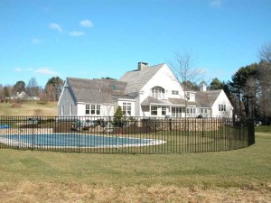 Wrought iron swimming pool fence enclosure at private residence designed by Hugh J. Collins Jr. Landscape Designer, Inc.