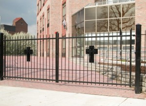 Swing gate at the Little Sisters of the Poor. Note waterjet cut crosses. Bronx, New York City