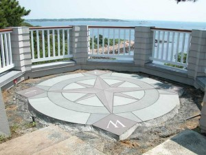 8 foot Diameter Compass Rose waterjet cut from 2 thick bluestone using three different colored stones. N,S,E and W are from 1/4 thick stainless steel.