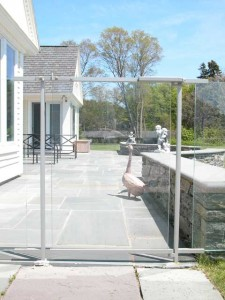Painted stainless steel Swimming Pool fence enclosure and gates at private residence designed by Hugh J. Collins Jr. Landscape Designer, Inc.