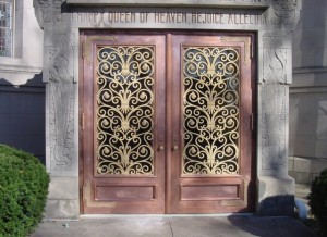 New solid copper doors were made to replace failing 100 year old copper clad-wooden doors at The Calvary Cemetery in New York City. Only the hinges and center bronze grille were re-used. Fabricated and installed by Cassidy Bros. Forge. (One of five sets shown.)