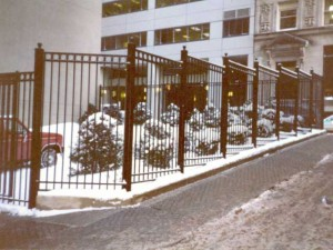 Perimeter fence and sliding gate at a parking lot for the Fidelity Investments Office tower, Boston, MA.