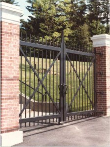 39 foot wide gate by 11 foot tall of the College of the Holy Cross. Cassidy Bros Forge fabricated these gates in 1982 along with over 1000 feet of fence and five other entry gates in Worcester, MA.