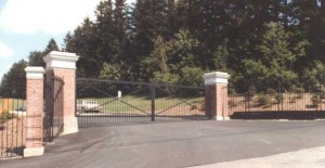39 ft wide gate by 11 ft tall at the College of the Holy Cross in Worcester, MA. Cassidy Bros Forge fabricated these gates in 1982 along with over 1000 ft of fence and five other entry gates.