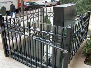 Gate and fence surround for an exterior ADA elevator