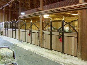 Graceful wrought iron grates decorate this horse barn.