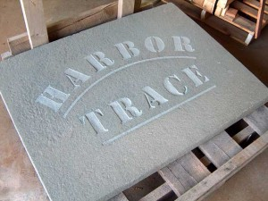 Waterjet template cut from steel then placed over bluestone and blasted lettering was applied.