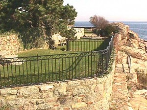 Wrought iron swimming pool fence enclosure and guardrails at private residence designed by Hugh J. Collins Jr. Landscape Designer, Inc.