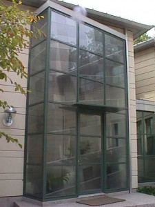 Painted stainless steel and glass entry at private residence.