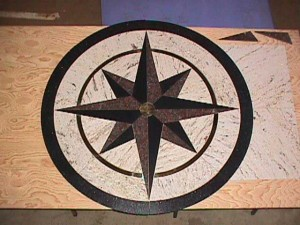 4 foot diameter granite and bronze compass rose.