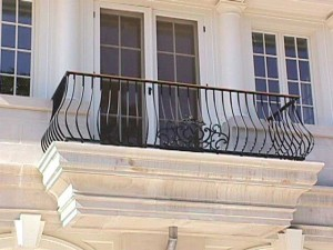 Wrought iron and bronze balcony: curved, forged, waterjet and colorgalvanized.