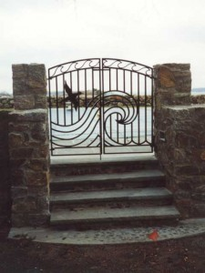Wrought iron swimming pool fence enclosure and gates at private residence designed by Hugh J. Collins Jr. Landscape Designer, Inc.