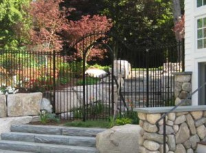 Wrought iron pedestrian gate at a private residence.