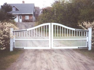 Wrought Iron Gates from steel to mimic a pair of wooden gates with iron hinges. Plum Island, Newbury, MA