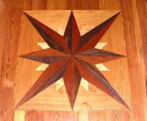 Wooden compass rose 3 feet x 3 feet from cherry, walnut, maple, ash and southern pine. Waterjet carving.