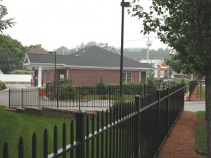 Several Hundred feet of wrought iron fencing to enhance the landscaping and protect the public from a decorative pond.