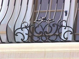 Detail of balcony with waterjet details embellished with hand forgings.
