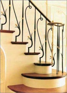 Hand forged iron and bronze railing in a private residence.