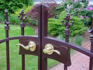Wrought Iron Pedestrian Gate at Private Residence with waterjet lock box.