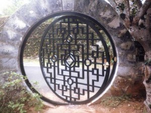 Bermuda Moon Gate. Private residence, Bermuda. Main pattern of the gate was cut from heavy aluminum plate then a heavier frame was rolled and welded. Note that the gate pivots at the center.
