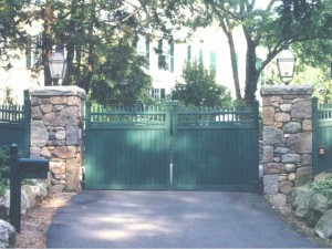 Galvanized steel gate frame with stainless steel pintles sleeved with bronze bushings and bronze washers. A galvanized steel superstructure is embedded into the stone columns at a private residence. The frames were covered with wood for privacy and gate operators were added.